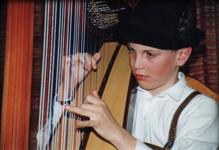 junger Harfenspieler